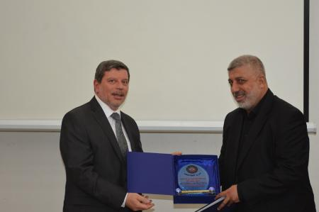 President of the university presents certificates and souvenirs for the participants in the first international conference