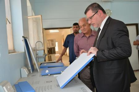 The university president checked out the new samples of supplying the basic scientific labs