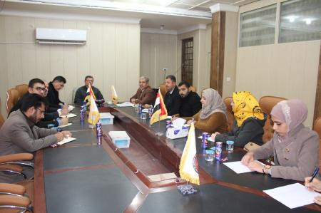 President of the University head meeting with staff of  the Dept. of  quality assurance and academic accreditation