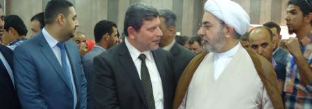The President in the corridors of the University of Babylon with Sheikh Amer Al-Kufaishi